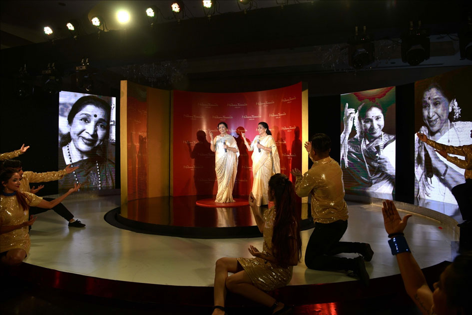 Veteran singer Asha Bhosle with her wax statue that was unveiled at the Madame Tussauds museum in New Delhi.