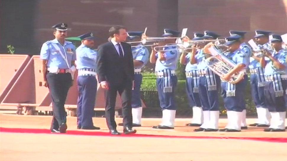 French President Emmanuel Macron and wife Brigitte Macron inspects guard of honor at Rashtrapati Bhawan