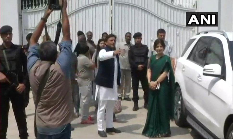 Akhliesh yadav and dimple yadav leaving government bang low
