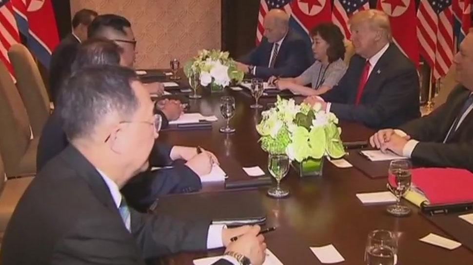 U.S. President Donald Trump sits next to North Korea''s leader Kim Jong Un