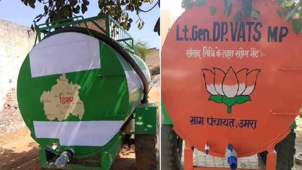 हरियाणा: पानी के टैंकर पर दुष्यंत चौटाला का नाम छिपाया, तो बोले- पत्थरों से नेताओं के नाम भी हटवा दो