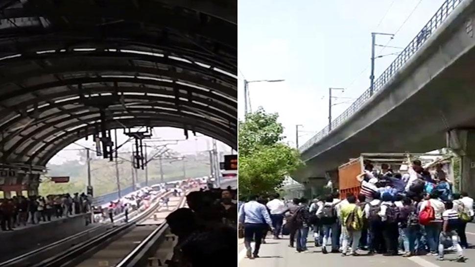 VIDEO: Delhi Metro रुकी तो ट्रैक पर चल दिए लोग, ट्रकों से पहुंचे ऑफिस, बीच रास्ते पर ही करने लगे काम