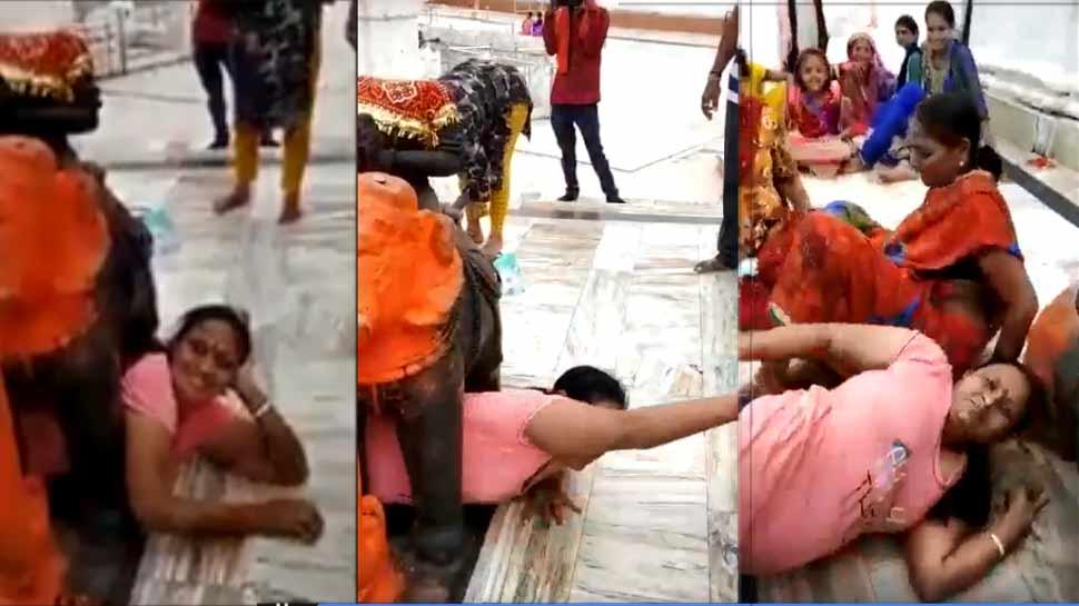 मनोकामना पूरी करने हाथी की मूर्ति के बीच पहुंची महिला, बुरी तरह फंसी, देखें VIDEO