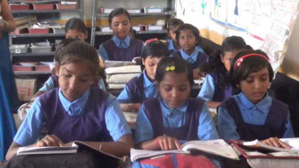 Student being taught about savings in primery school of chattisgarh