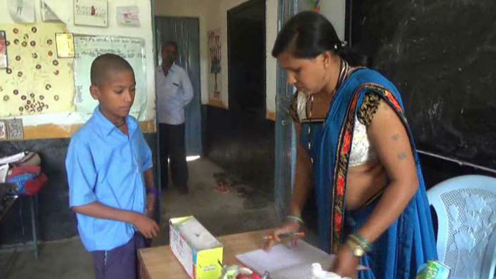 Student being taught about savings in primary school of chattisgarh
