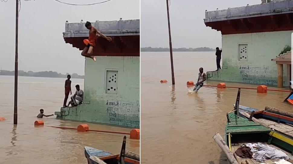 VIDEO: मिर्जापुर में उफान पर गंगा, बच्चे लगा रहे जानलेवा छलांग