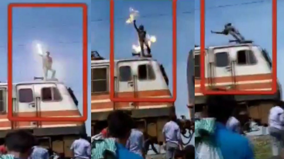 VIDEO: ट्रेन पर चढ़कर सनकी युवक ने छुआ हाईटेंशन तार, पल भर में लगी आग और फिर...