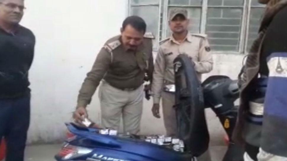 बिहार: स्कूटी से बरामद की गई 274 बोतल शराब, पुलिसकर्मी भी रह गए हैरान