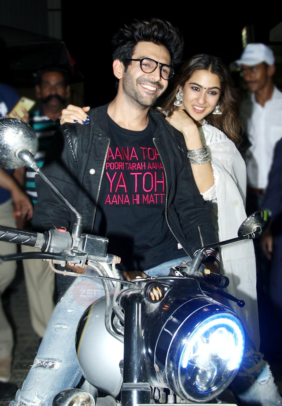 kartik aaryan and sara ali khan on bike