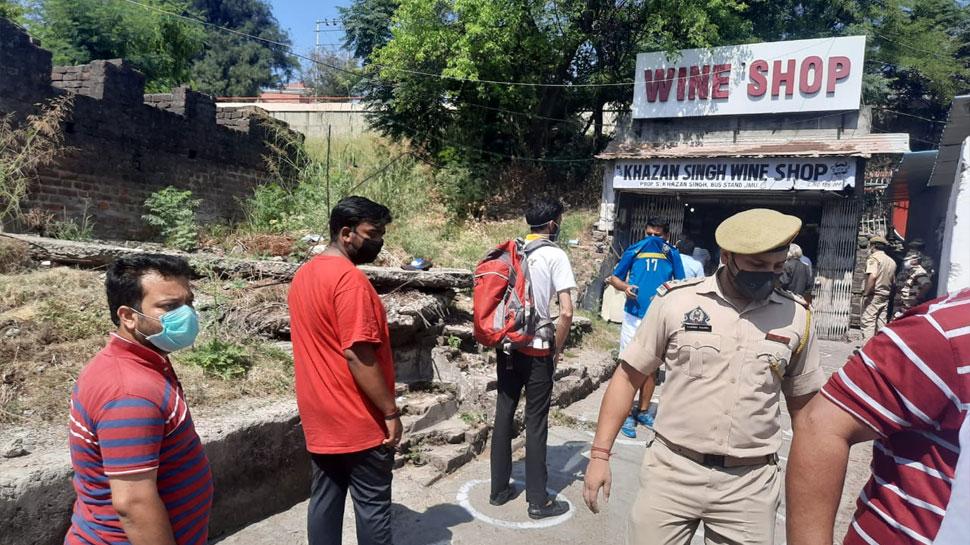 Long queues outside liquor shops in Jammu