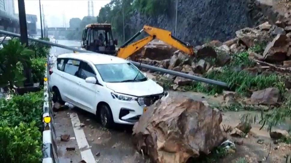 Heavy rains pound Mumbai landslide hits road