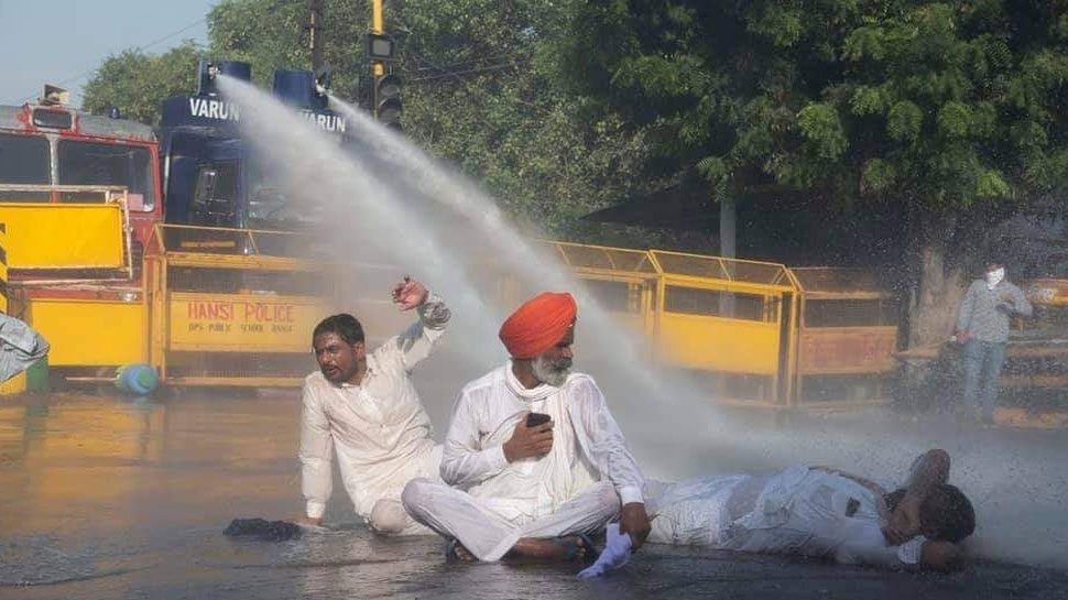 farmers prortest police used water canon on protestors