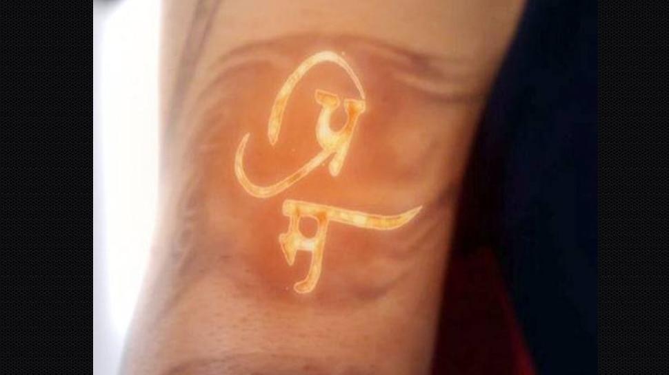 Virat Kohli fater name prem tattoo