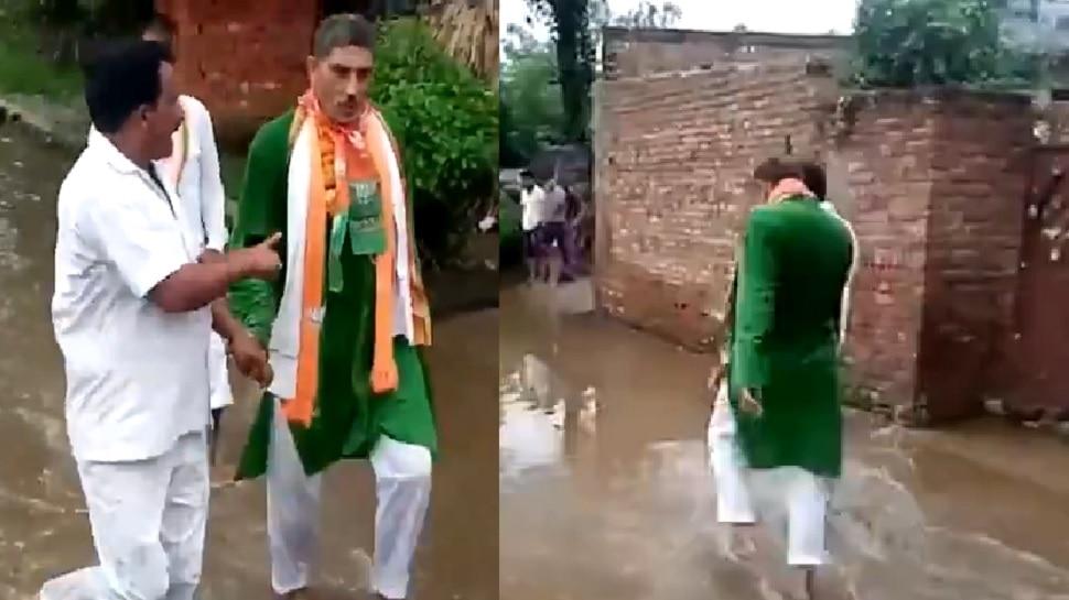 हापुड़ में नाराज पब्लिक ने विधायक को नंगे पांव सड़क पर जमा सीवर के पानी में चलवाया, VIDEO वायरल