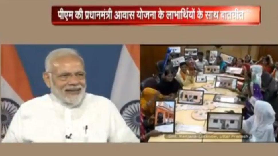 PM Narendra Modi interacts with Pradhan Mantri Awas Yojana beneficiaries across the nation.