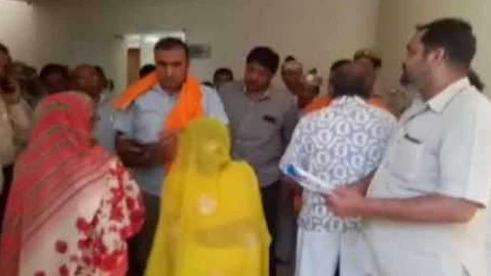 80 year senior citizen grovel under feet of commissioner in mathura