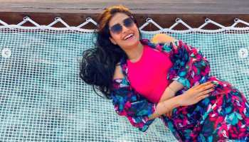 Yuzvendra Chahal wife Dhanashree Verma Black Floral Swimsuit in Maldives Island, Honeymoon, Blue Water, Chahal-Dhanashree Honeymoon, Chahal-Dhanashree