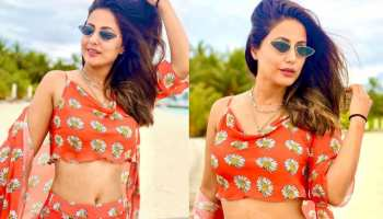 hina khan shares glamours photos in orange outfit