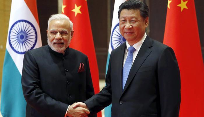 जिनपिंग से मिले पीएम मोदी, लखवी पर पाक को चीनी समर्थन पर जताई आपत्ति