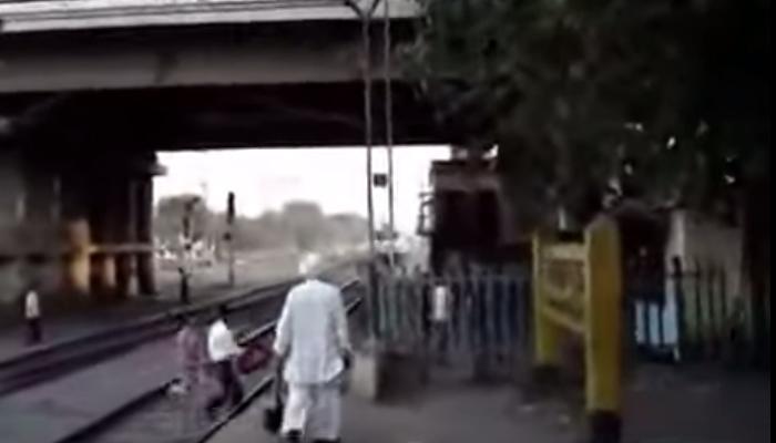 VIDEO में देखिए, कैसे यह जोड़ा हाई स्पीड ट्रेन की चपेट में आने से बाल-बाल बचा?