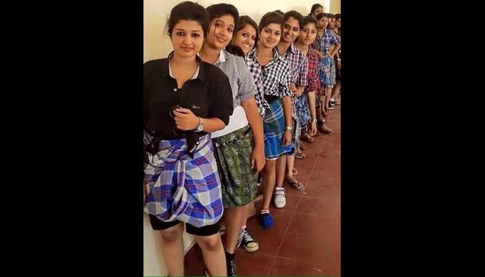 इन लड़कियों ने लुंगी क्यों पहनी है? जानिए क्या है वायरल हो रही इस तस्वीर का सच?