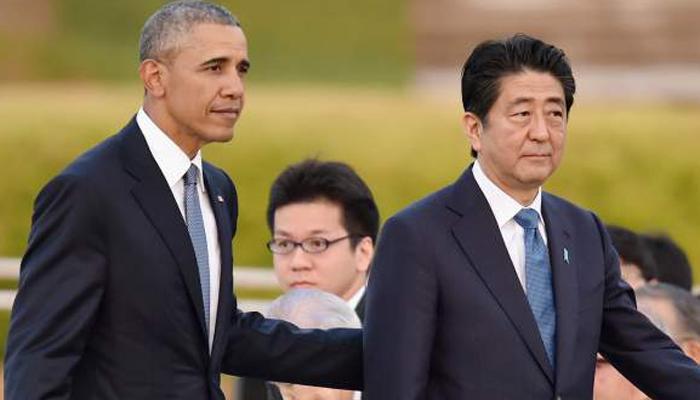 ओबामा और शिंजो आबे ने ऐतिहासिक यात्रा के दौरान पर्ल हार्बर में दी श्रद्धांजलि