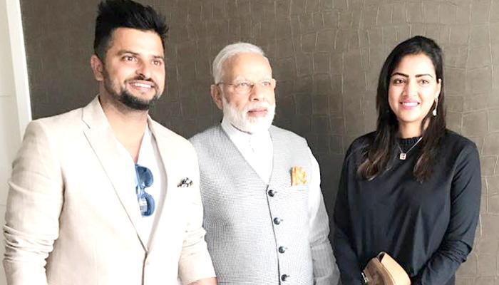 क्रिकेटर सुरेश रैना नीदरलैंड में पत्नी प्रियंका संग पीएम मोदी से मिले- See PICS