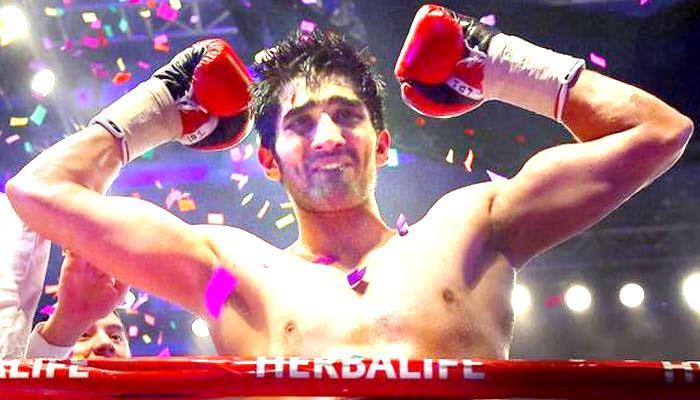 विजेंदर सिंह ने चीन के बॉक्सर जुल्फिकार मैमेतिअली को रोमांचक मुकाबले में हराकर हासिल किए एक साथ दो खिताब