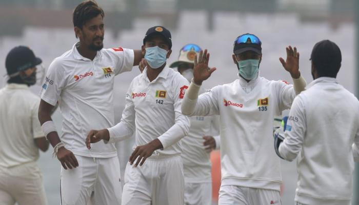 Sri Lanka players wear face masks on the kotla pitch of Delhi, India vs sri lanka, day 4