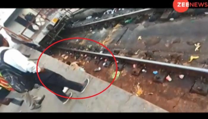 अविश्वसनीय: चलती ट्रेन के नीचे गिरा युवक, नहीं आई एक भी खंरोच, देखें VIDEO