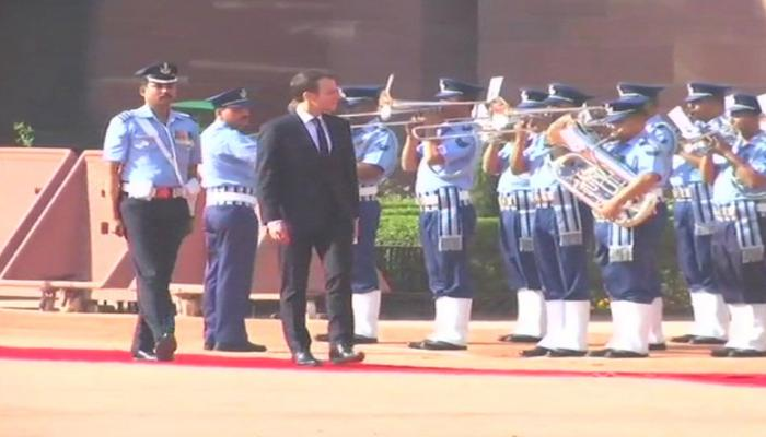 French President Emmanuel Macron and wife Brigitte Macron inspects guard of honor at Rashtrapati Bhawan