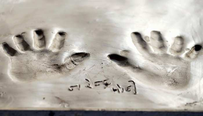 hand prints of PM Modi are imprinted on wet clay during the BRICS Summit