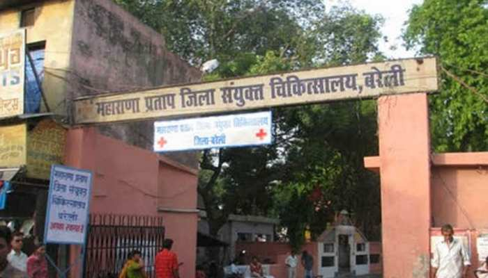 NRI ONLY: hospital did not provide ambulance, man carried ill son on back