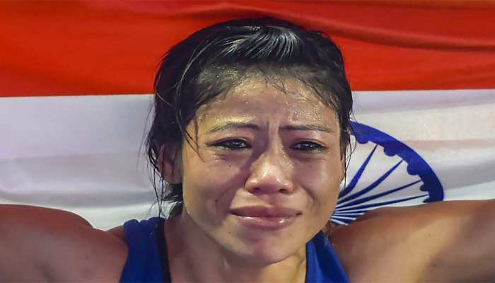 Indian boxer Mary Kom gets emotional as she celebrates after winning the final match of women's light flyweight against Ukraine's Hanna Okhota