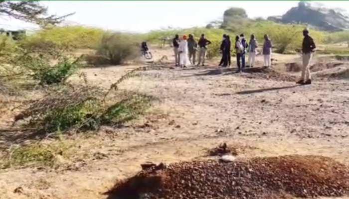पाली में महिला को दफनाने पर ग्रामीण कर रहे विरोध, कब्र पर पुलिस दे रही पहरा