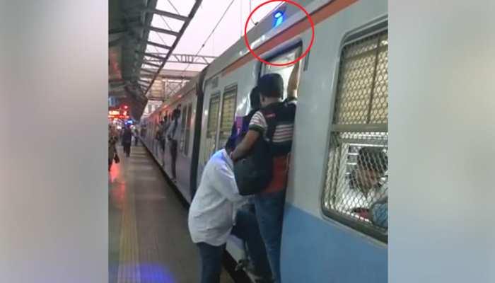VIDEO: डिब्बों के गेट पर लगाई गई नीली बत्ती बताएगी कि अब ट्रेन छूटने वाली है