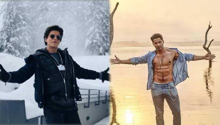 वरुण धवन का यह अंदाज है निराला, शाहरुख खान के सिग्नेचर पोज में दिखाए एब्स