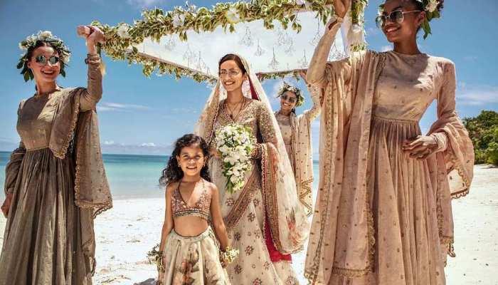 Sabyasachis recent photoshoot with Manushi Chhillar is spring wedding goals