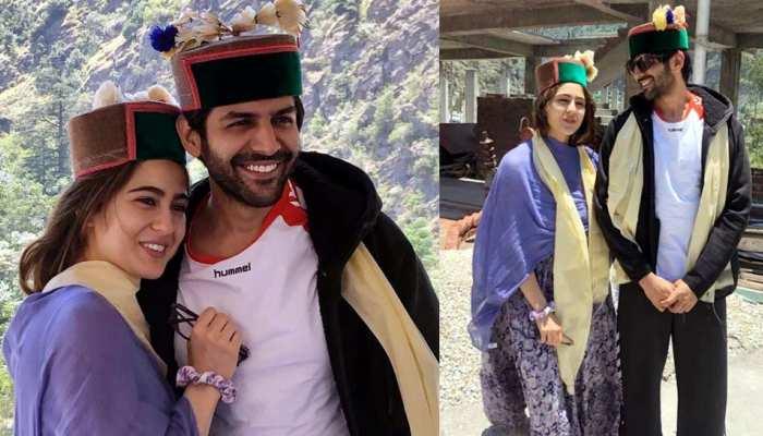 Sara ali khan and Kartik aaryan posed together wearing traditional Himachali caps