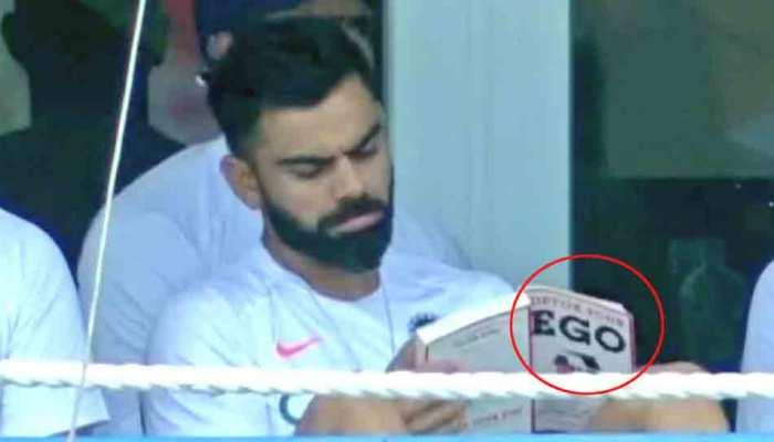 विराट कोहली 'डिटॉक्स यॉर ईगो' पढ़ते दिखे, लोगों ने कसा तंज- आपके लिए जरूरी थी ये किताब