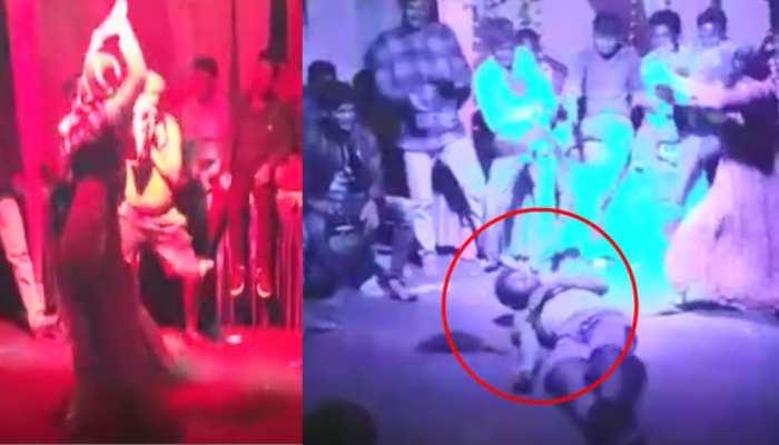 VIDEO: गणेश विसर्जन के बाद लड़की के साथ डांस करते-करते सिर के बल गिरा युवक, हो गई मौत