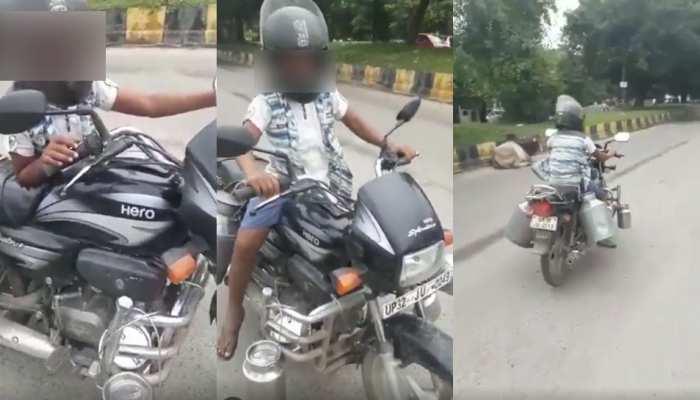 8 साल के बेटे की बाइक सवारी...पिता पर भारी! वायरल वीडियो के बाद हुआ भारी भरकम चालान