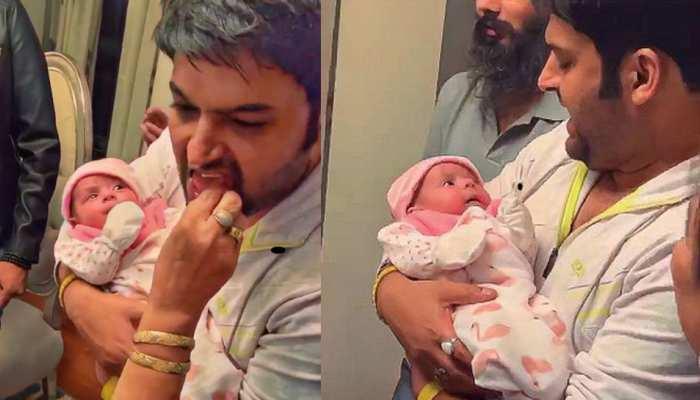 सामने आईं कपिल शर्मा की बेटी की पहली PHOTOS, पापा को यूं एक टक निहारती दिखी नन्ही परी