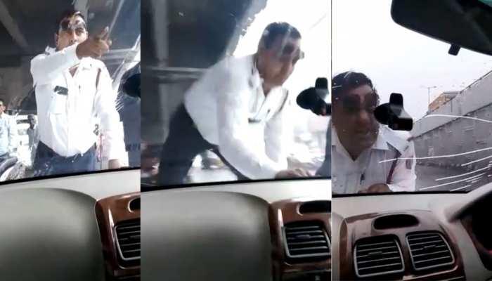 VIDEO: ट्रैफिक पुलिस कॉन्स्टेबल पर चढ़ा दी गाड़ी, बोनट पर चढ़कर बचाई जान