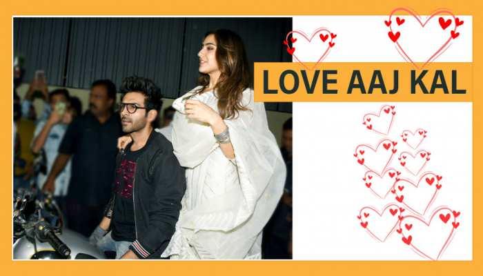 movie kartik aaryan and sara ali khan arrive on bike for love aaj kal special screening