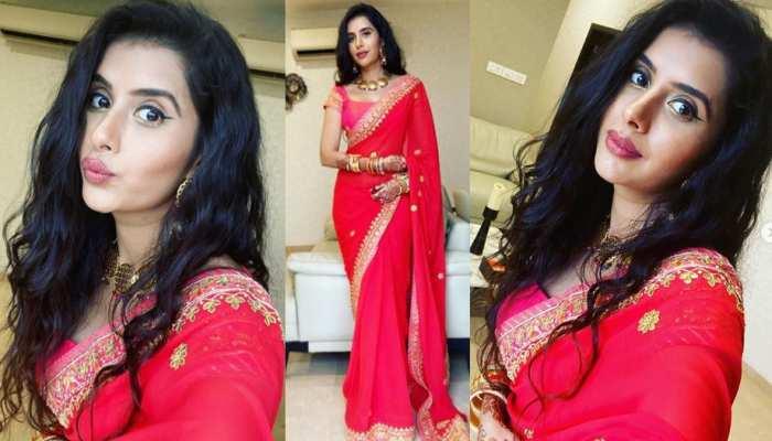 Charu Asopa celebrating Shravan puja in red sari