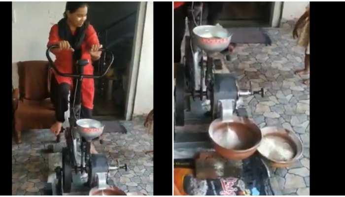 कसरत के साथ हो रही है गेहूं की पिसाई, Video में देखिए गजब का जुगाड़ू आविष्कार