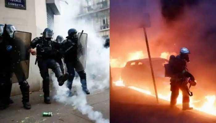 Paris में पुलिस और प्रदर्शनकारियों में हिंसक भिड़ंत, दुकानों की खिड़कियां तोड़ी, कारों में लगाई आग