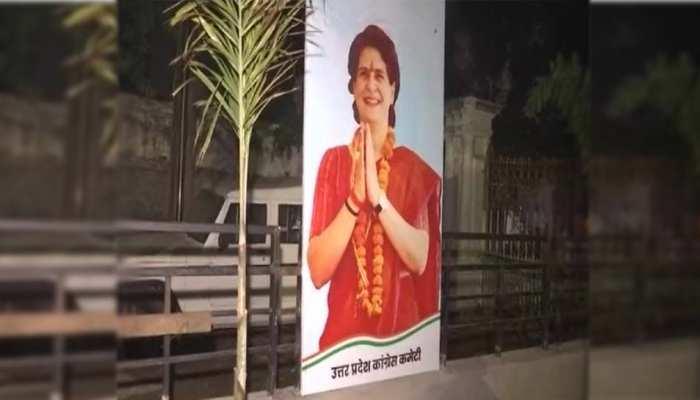 माथे पर तिलक, हाथ में कलावा और भगवा साड़ी में दिखीं प्रियंका गांधी, UP कांग्रेस मुख्यालय में लगा पोस्टर