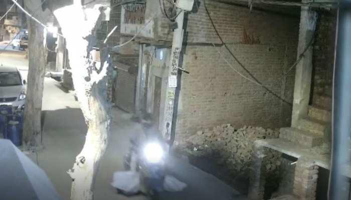 Delhi Rohini Prem Nagar man roamed with Dead body by scooter CCTV See Photos